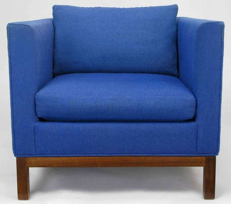 Very popular cube style club chair by Dunbar in the original blue wool upholstery with walnut Parson-style legs and apron. Loose seat and back cushions. Not certain if this is by Edward Wormley, or another Dunbar designer.