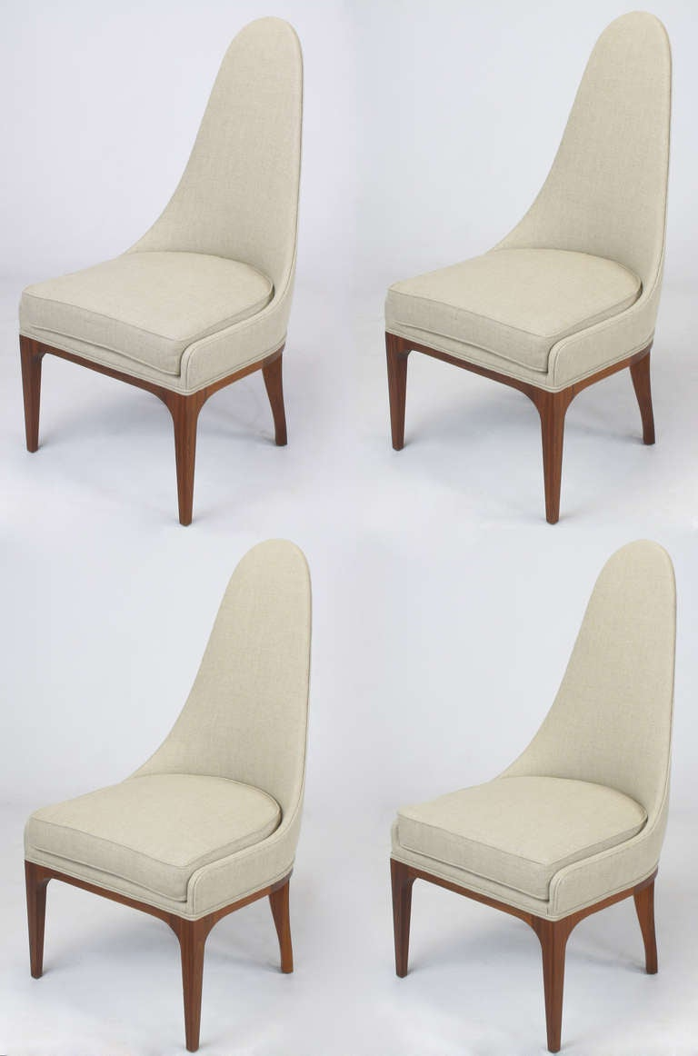 Set of four tall spoon back chairs with rosewood legs and apron. Restored in unbleached linen with new upholstery materials. Excellent profile with radius corner slipper sides and curved barrel style back. Almost identical to chairs of the same era