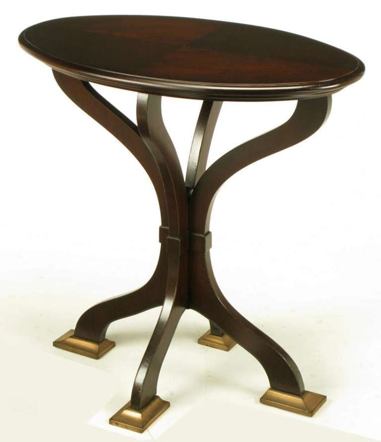 Oval cherrywood centre table with four section parquetry top, Art Nouveau four leg pedestal like base with cast bronze feet. Four sinuous legs meet in the center with a banded style carving, then curve outward, creating the allure of a pedestal with