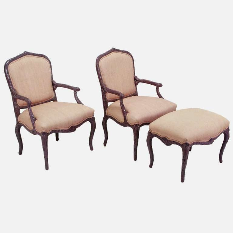 Pair of dark lavender-purple lacquer and puce silk/linen upholstered Louis XV style faux bois armchairs, with matching cabriole legged ottoman. Very well constructed with hand-carved hardwoods and high end tactile upholstery. From Casa Stradivari, a