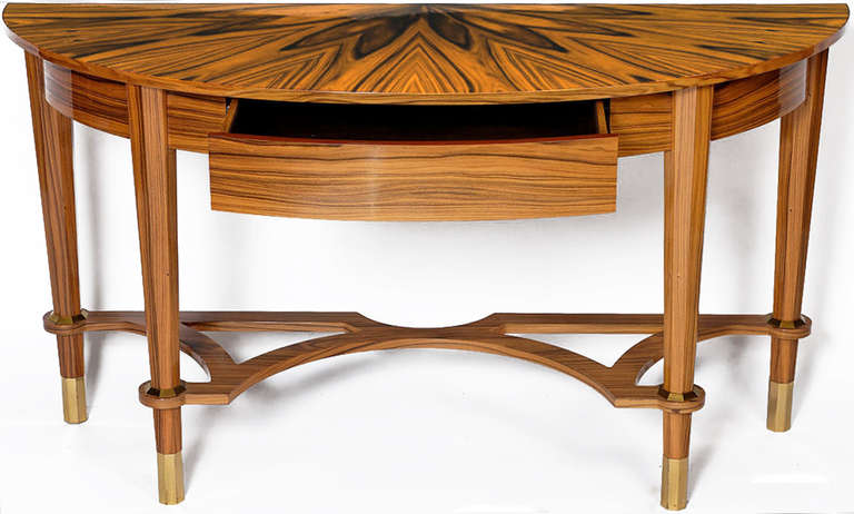 One of a kind custom pair of Michael De Santis Brazilian rosewood demilune console tables. Sunburst pattern tops, and a single velvet lined drawer each. Octagonal tappred legs, with brass ferrules and sabots.