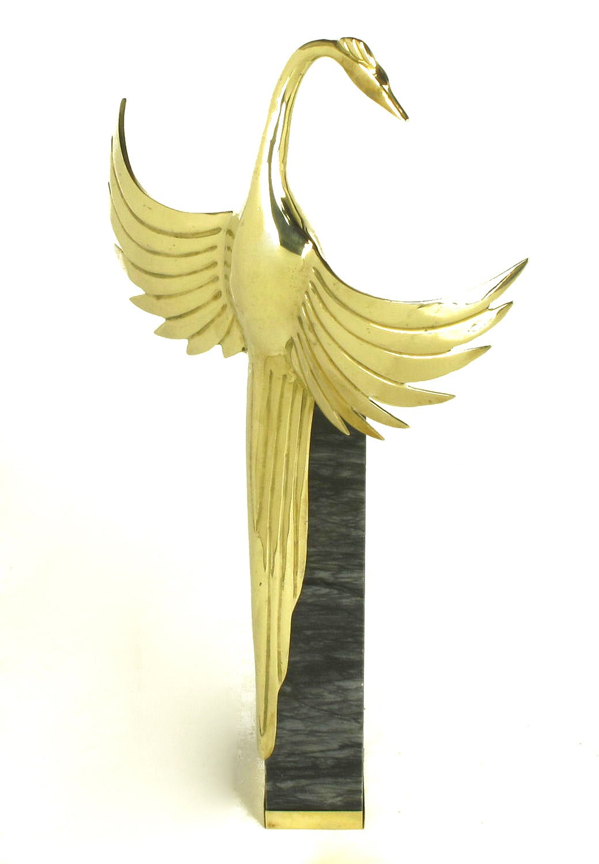 Pair of Art Deco inspired solid brass crane sculptures surmounted on dark grey Carrara marble pedestals with brass sabots. One sculpture stands 27.5