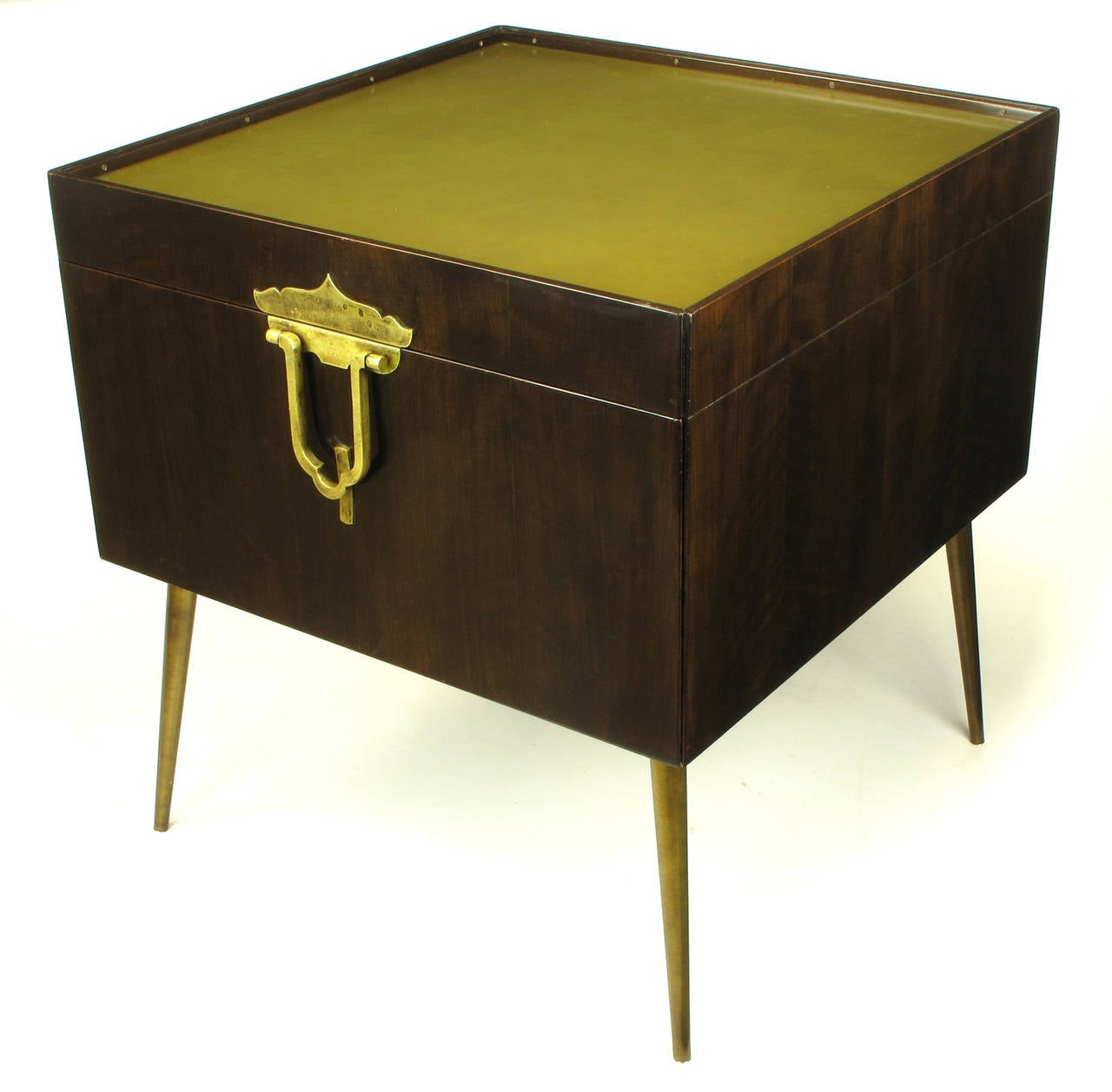 Often misattributed to Monteverdi Young, this bar cabinet constructed of walnut woods, solid brass, and anodized aluminum is actually designed by Bert England for his John Widdicomb Furniture Orientation Group. A single door is accessed by a large