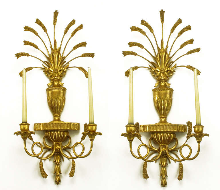 Italian tole metal and resin candelabra sconces with antiqued gilt finish. Looped candle holder arms and wheat stalks featured with centre vase. Second pair available.
