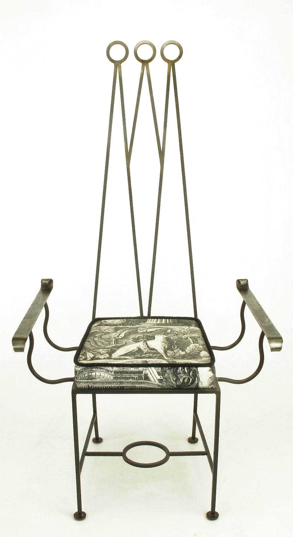 Set of eight custom designed blackened wrought iron dining chairs. Set consists of
