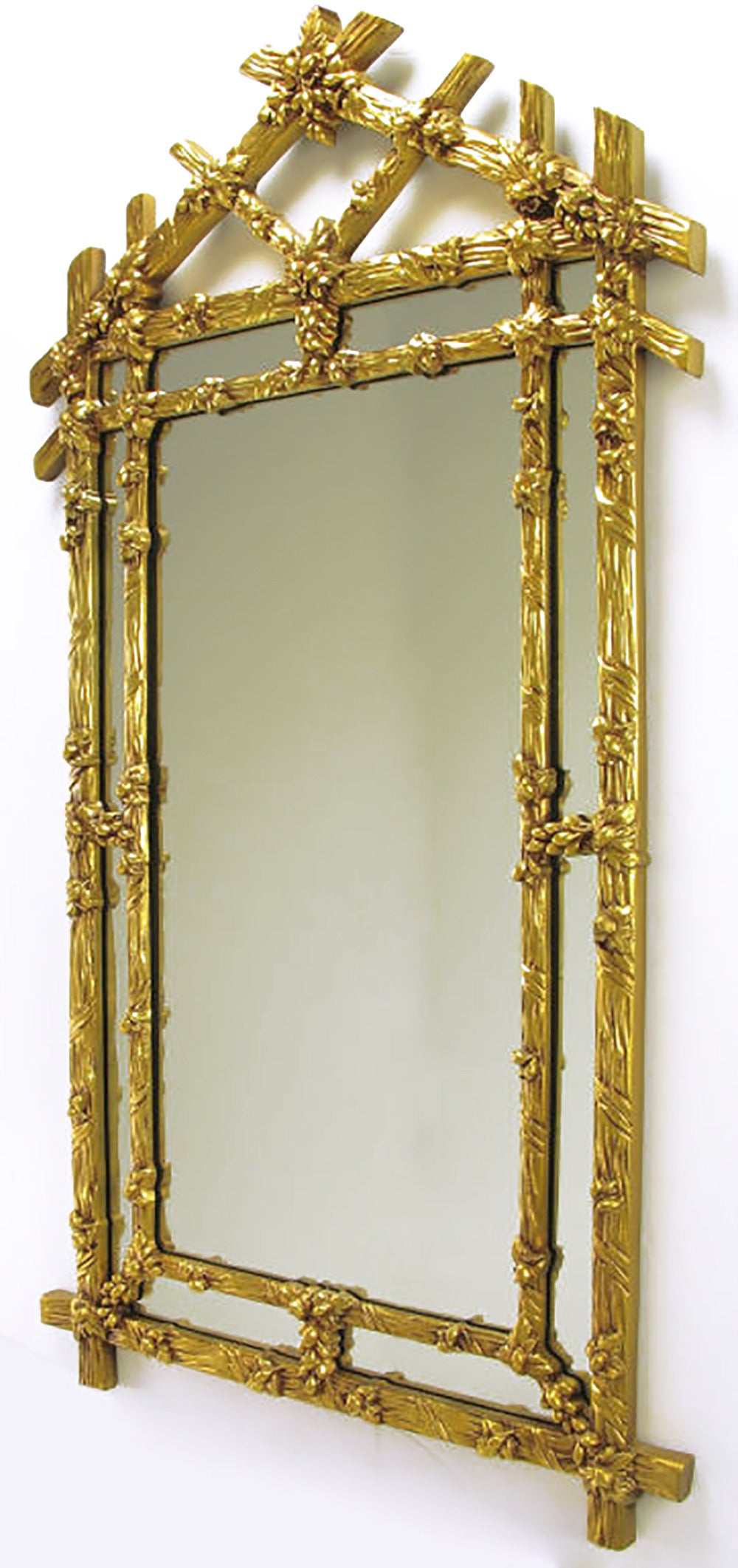 Black Forest style mirror in gilt finish with foliate detailing and segmented frame in frame.