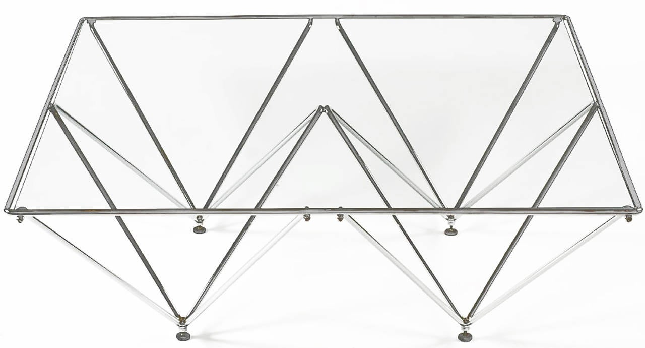 Supported by chrome metal structures shaped as inverted pyramids, this table has a clean and light look. Evocative of a Paolo Piva design, at an affordable price.
