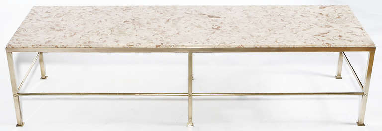 Clean lined Dunbar brass and marble coffee table designed by Edward Wormley. Solid brass bar frame with solid brass rod stretchers and brass square plate feet. Beautifully veined rouge and cream Portuguese marble inset top.