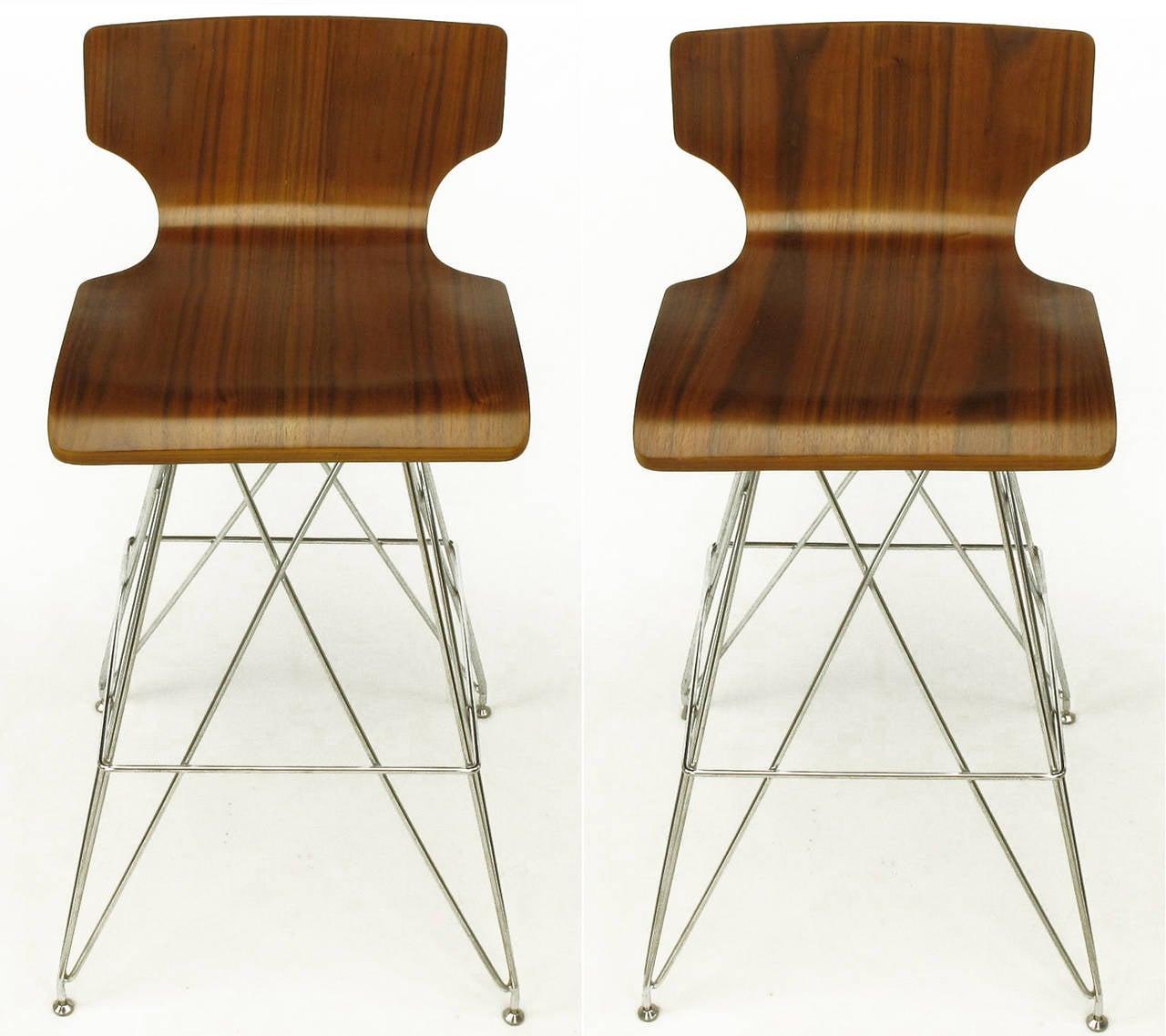 Pair of bentwood seat bar stools with figured teak veneer, low backs and chromed steel