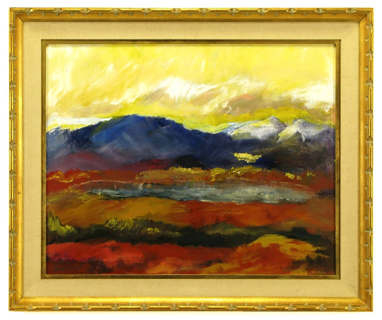 Colorful expressionist mountain scene with lake in reds, gold, yellow, violet, blue and white; most likely by Barbara Leadabrand (1922-1994), a renowned Pasadena painter and sculptor. Giltwood frame with gold leaf and linen wrapped matting. Framed