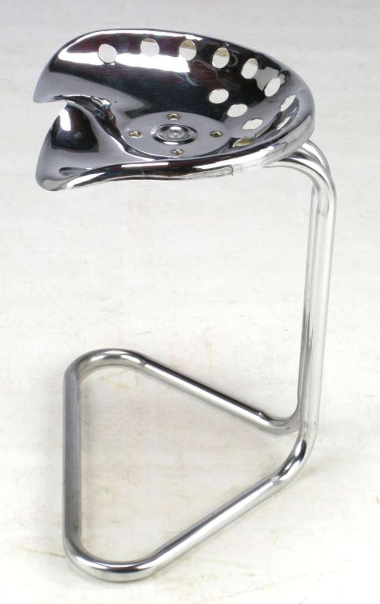 Cantilevered chrome tractor seat inspired by the work of Achille and Pier Giacomo Castiglioni for Zanotta.