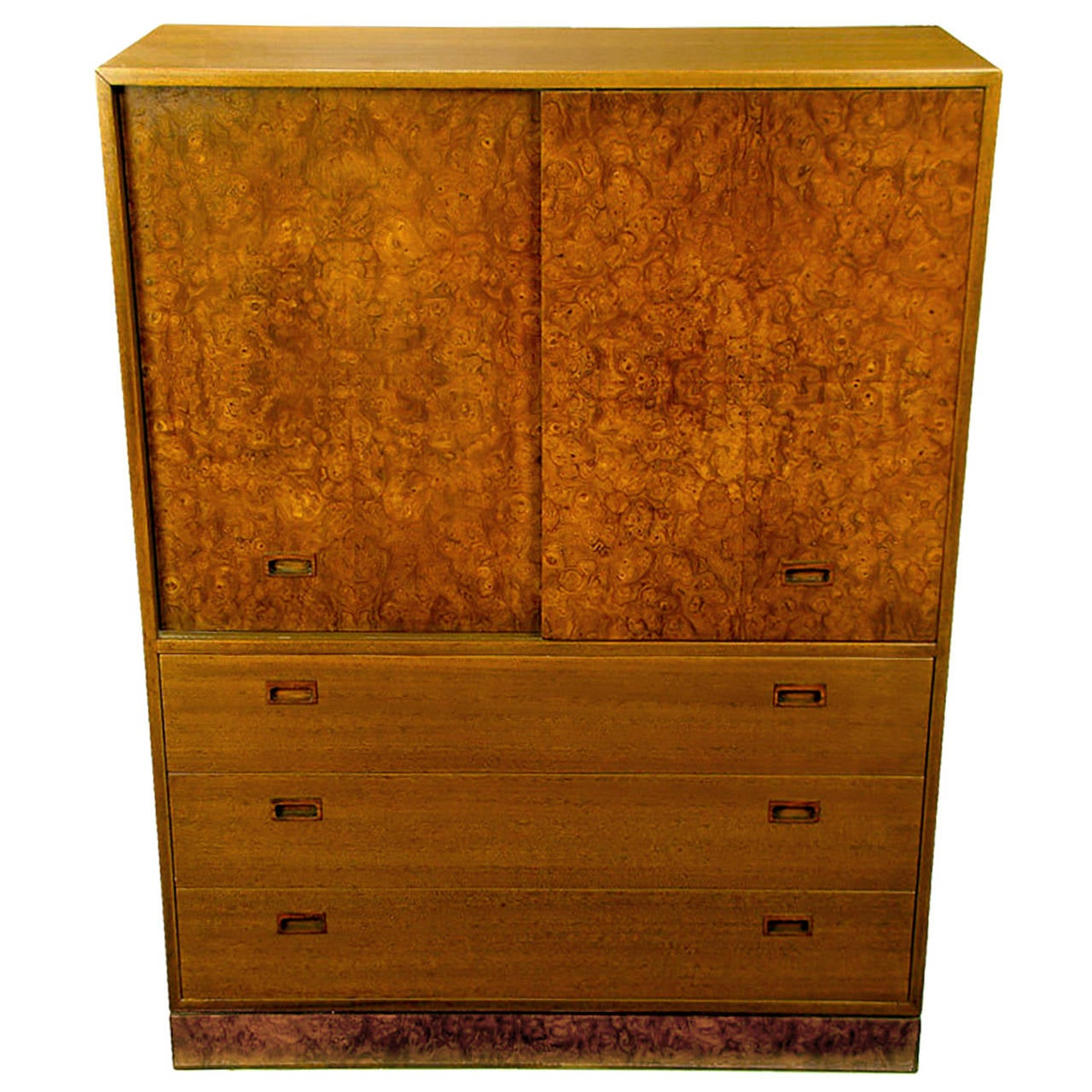 This sleek clean lined Harvey Probber gentleman's bureau features burl wood doors with recessed rosewood pulls. The doors slide to reveal three cork lined trays and four shirt drawers. Three large lower drawers come with the same recessed pulls and