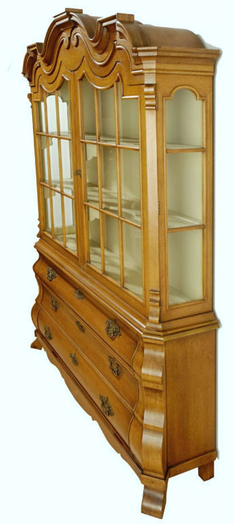 Impressive cabinet from Draper's 1963 Viennese collection for Henredon. Features bombe base with three drawers, splayed feet and intricately chased brass drop pulls. 