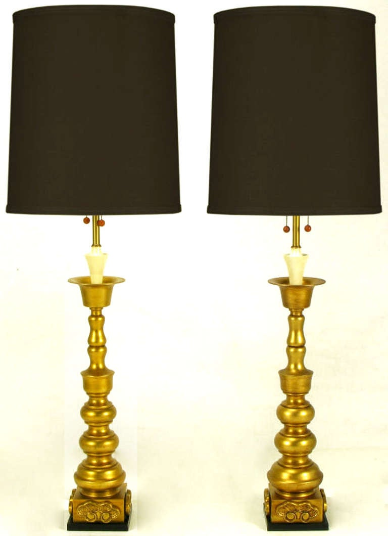 In impeccable condition, these lamps by Marbro have a black lacquered base, Asian ornamentation, and a gilt body. Complete with original black finials and renowned Marbro attention to detail.