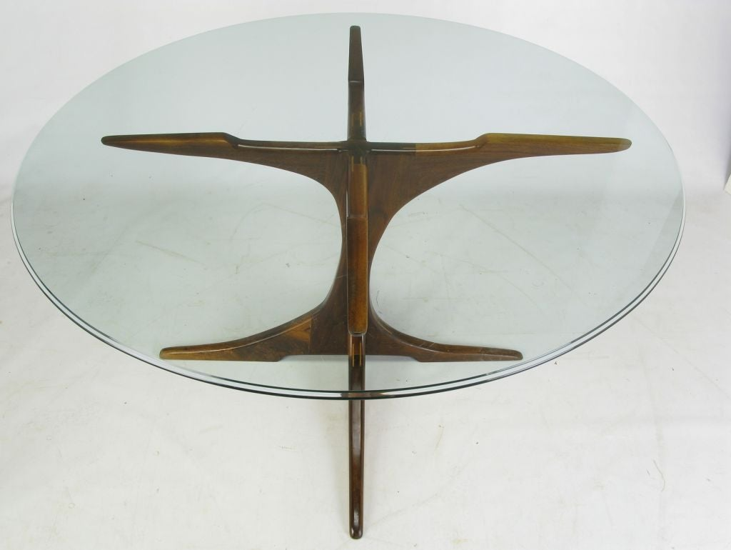 this custom x base teak wood dining table with glass top is no longer