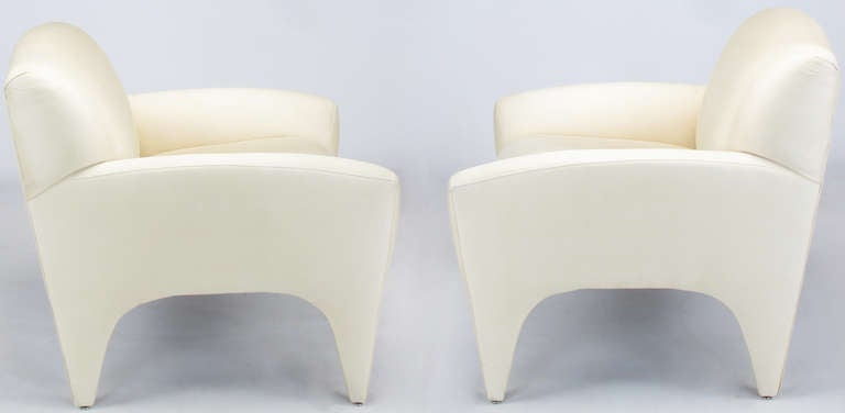 Pair of fully upholstered Art Deco inspired lounge chairs by Preview. Ivory silk upholstery, fixed cushions.