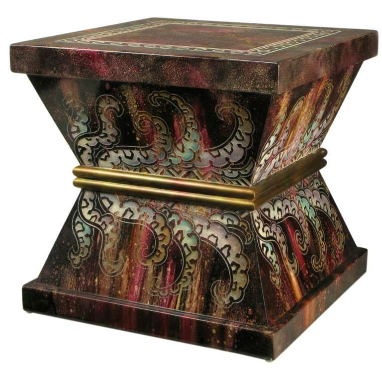 Very colorful, and much like the cast resin pieces of Phyllis Morris, this side table or pedestal sports etched and stylized paisleys, with a gilt double bar middle. The top is also etched with a square double border with internal circles. A most