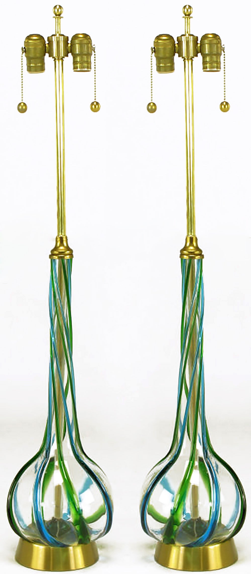Pair of Italian Murano glass long stem gourd form table lamps. Handblown and twisted with relief ribbon in blue and green. Spun brass base with brass stem and brass double socket cluster with pull chains.
