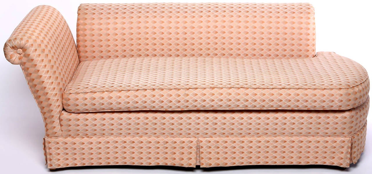 A 20th century interpretation of Madame Recamier's sofa or chaise with rounded end. Roll-form arm and back are independently mounted to the base.  Can be re-upholstered with or without the skirt as the legs are clean lined tapered dowels.