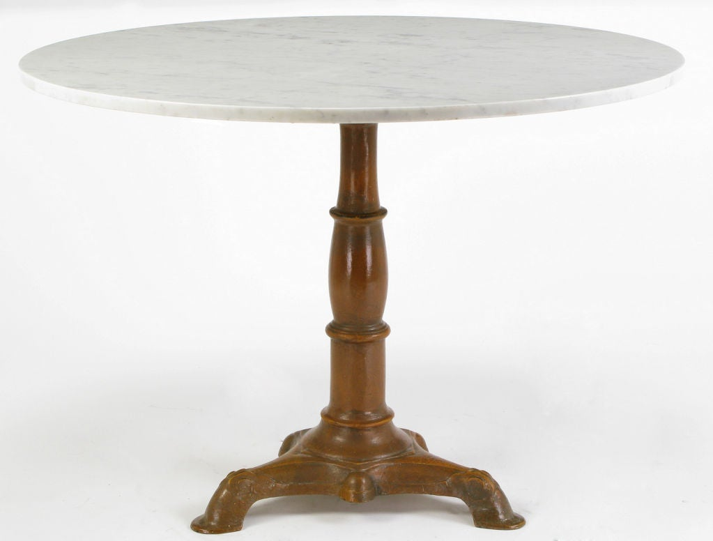 Round carrera marble and cast iron pedestal dining table for Cast iron dining table