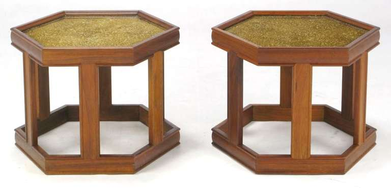 Pair of hexagonal side tables by John Keal for Brown Saltman. Finished in a medium walnut, with a brilliant reverse-painted and textured glass top in gold and taupe tones. Grouped as a pair, they would function well as a coffee table.
