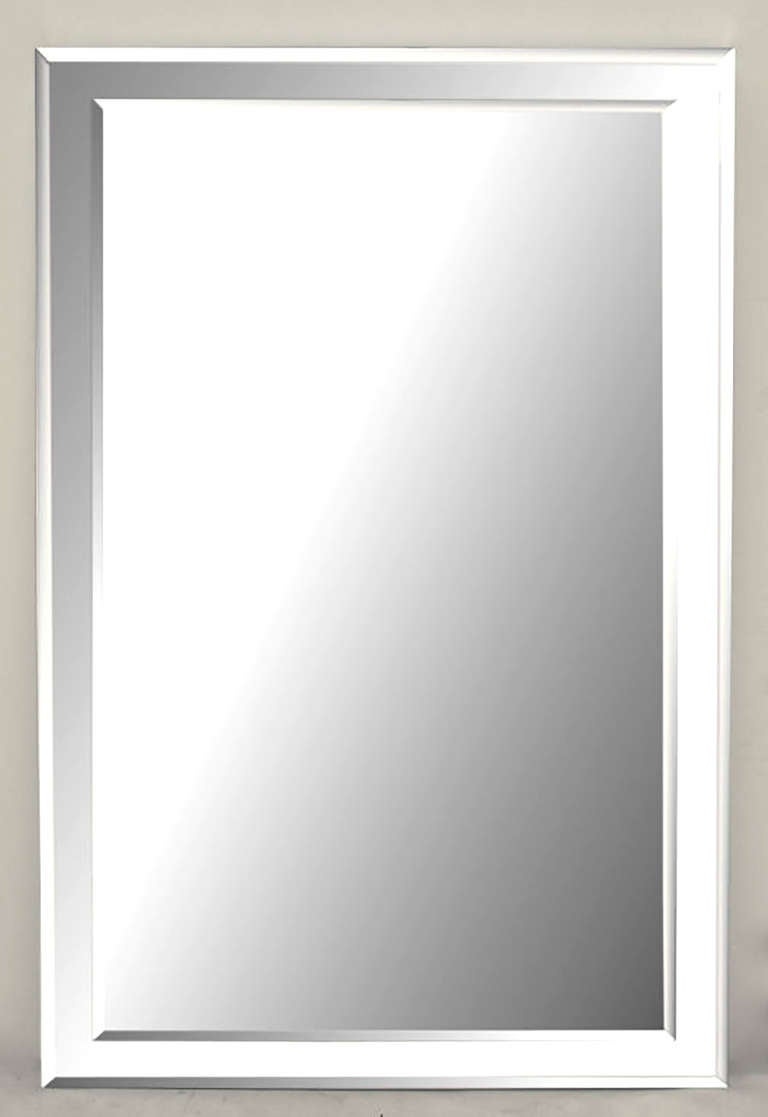 Heavy and well made, custom designed wall mirror with beveled glass mirror over a larger beveled glass mirror. Mirrored top, bottom and sides are nearly 2