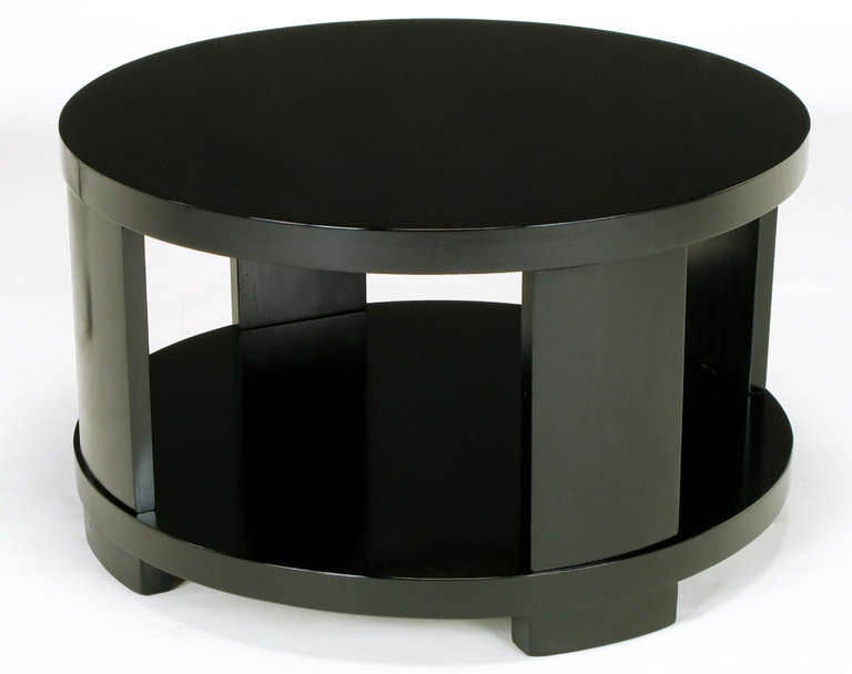 Custom bench built round two tiered coffee table with four curved supports. Newly refinished with back water based die and clear lacquer. Would also make an excellent side table. Similar to designs by Edward Wormley for Dunbar.