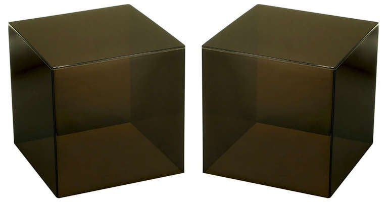 Pair of dark smoked Lucite cube tables. Wonderfully square and recently polished, can be used as a split coffee table or unexpected end tables.