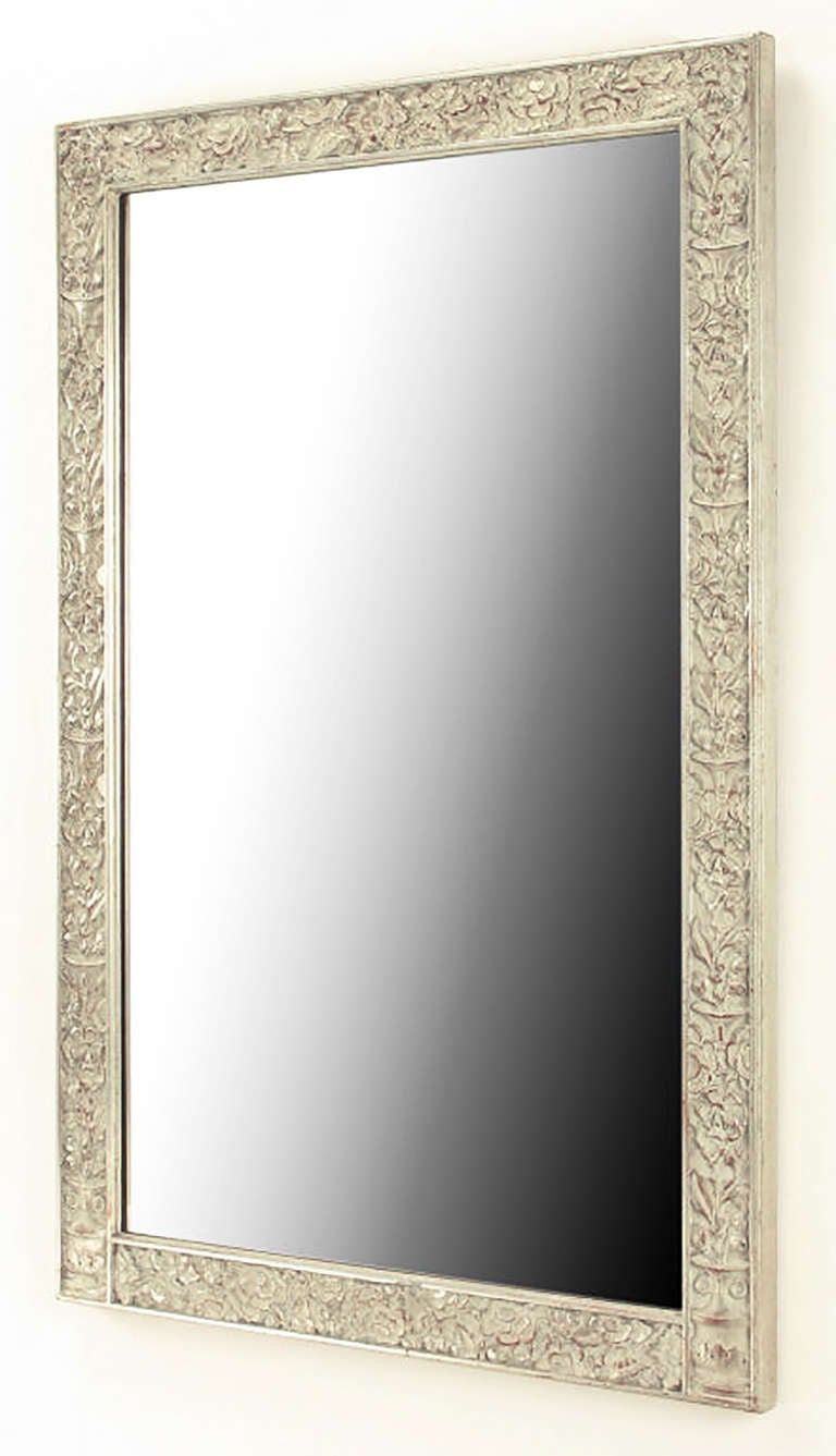 Carved American Art Deco style flowers surrounding a rectangular wood frame in aged silver leaf. Some minor losses of silver leaf due to age. Bears a tag from the John M. Smyth Company, a venerable Michigan Avenue furniture retailer.