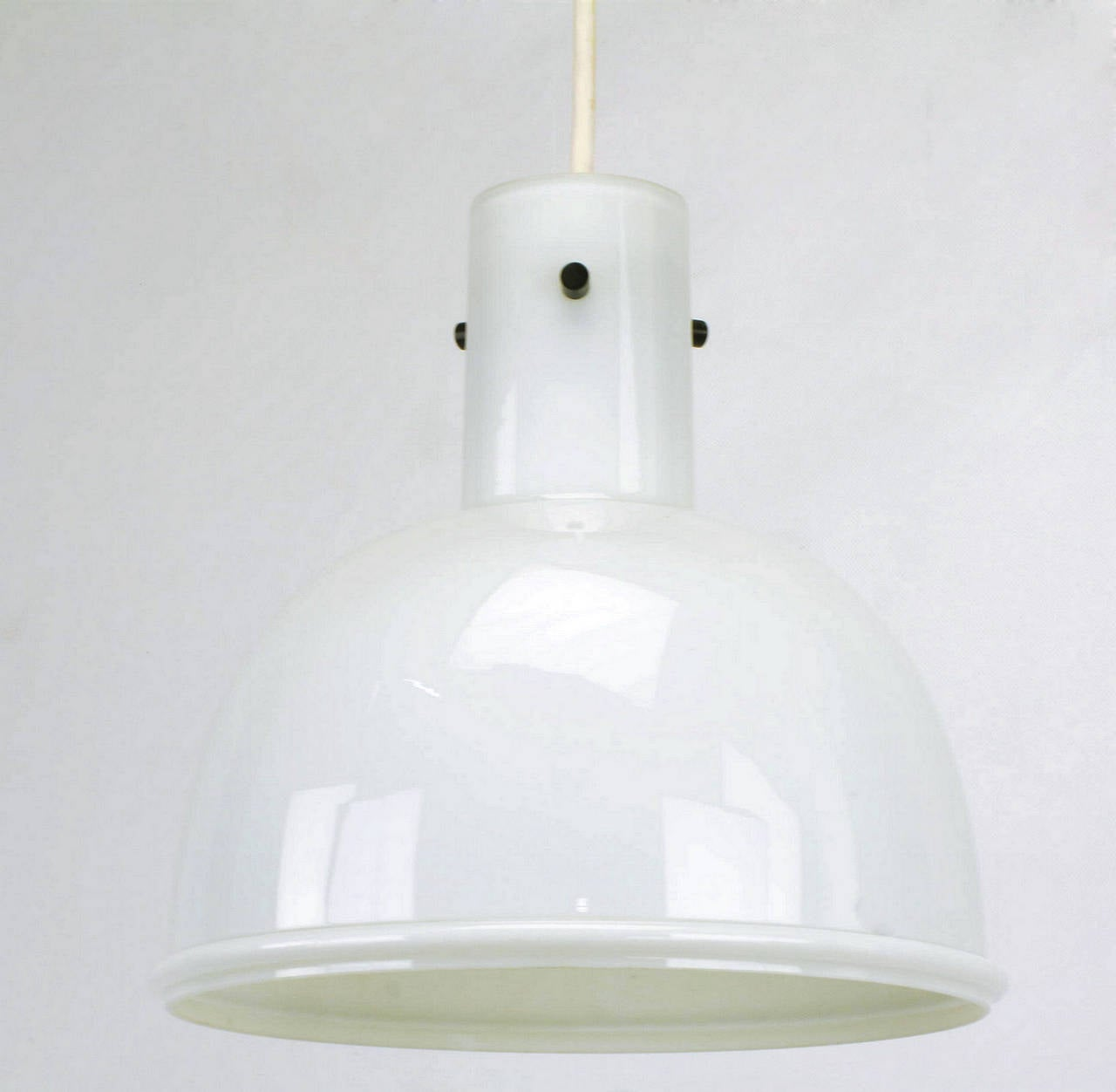 Lightolier cased glass pendant light with single cord suspension and three black metal stud fitters. 1970s import made by the stellar German firm Glashütte Limburg.   Overall drop with cord and canopy is 26