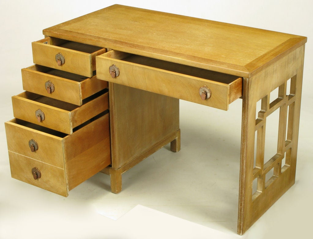 Landstrom Furniture desk in bleached and limed mahogany. aged nickel over copper drop disc pulls and trefoil escutcheons. Five drawers to the left, a single drawer above the opening and a latticed side support.  Landstrom was a fine furniture maker