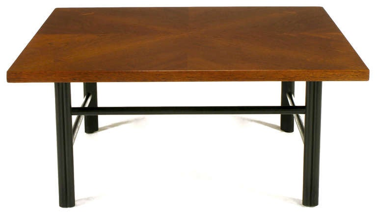 Baker Furniture Far East Group mahogany coffee table with ebonized triple reed legs and offset stretchers. Parquetry four square patterned surface with trefoil shaped inlay at the joinery of the legs to the top.