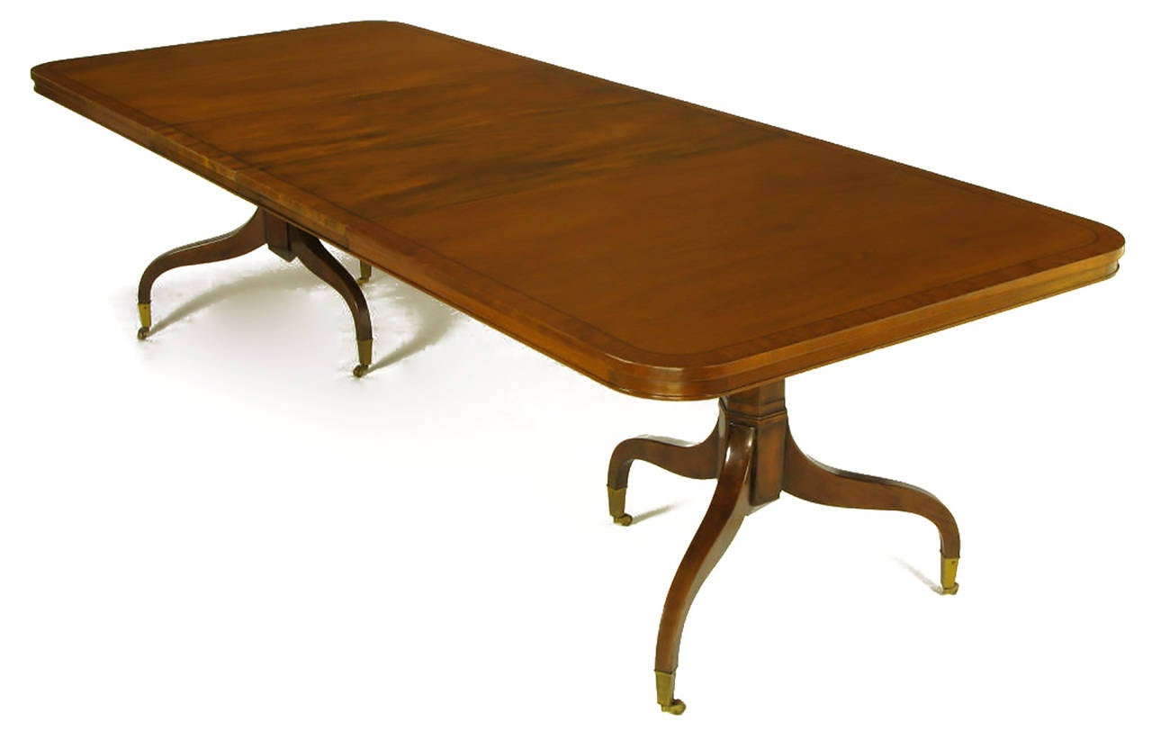 kittinger mahogany dining table with unusual double pedestal base for