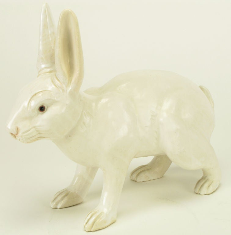 Majolica pottery white rabbit statue with gloss glazing and pink toning to nose and ears. Most likely Italian in origin.