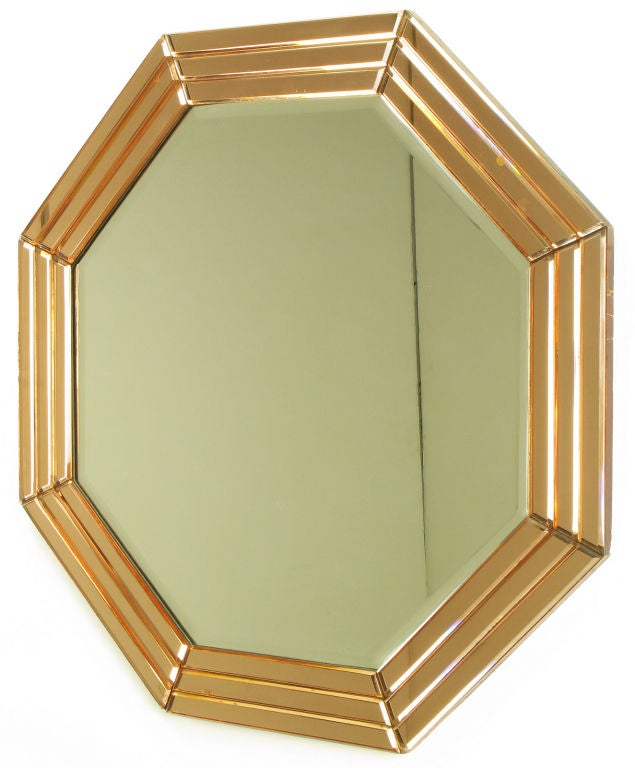 Segmented and beveled art deco style peach glazed octagonal mirror surround applied to woo with center beveled octagonal mirror.