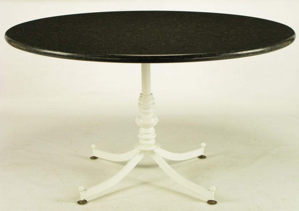 White lacquered cast metal dining table with round black for Round granite dining table