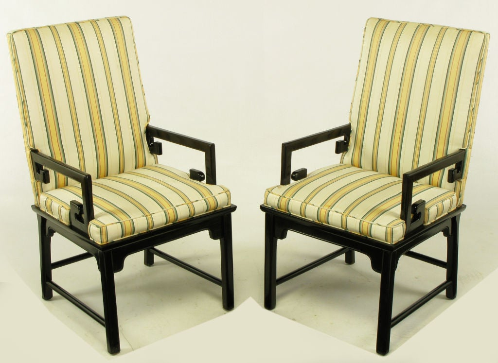 Pair of Michael Taylor for Baker Chinoiserie Greek arm chairs. Ebonized mahogany frames with platform seat, characteristic Taylor bracketed apron with doweled side and rear stretchers. Upholstered in a butter yellow and cadet blue striped silk blend