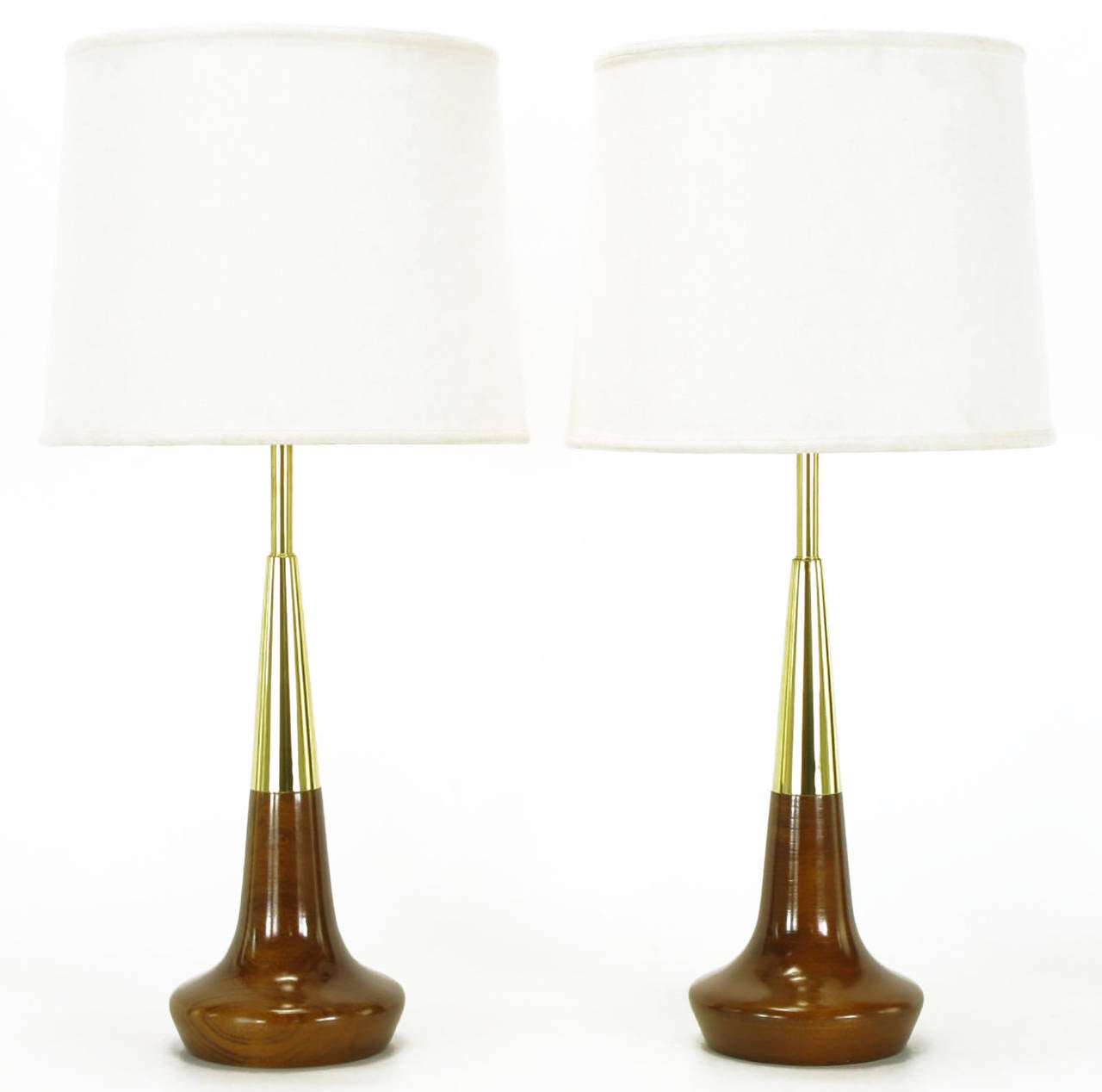 Pair of Lightolier turned solid walnut and brass table lamps. With brass stems, white lacquered metal cups and cast opaque and white glass diffusers. Reportedly a rare and early Gerald Thurston design. Restored and rewired.