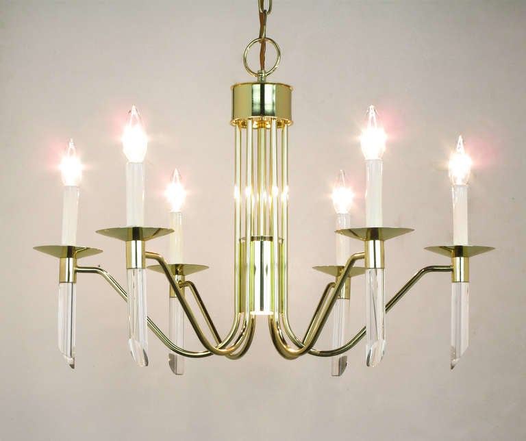 Six arm, brass and lucite chandelier by Forecast Lighting circa 1980s. Inverted spider-like arms with thin bobeches and angle cut lucite rods. Center downlight as seen in image 6. Total drop with chain and canopy is 40