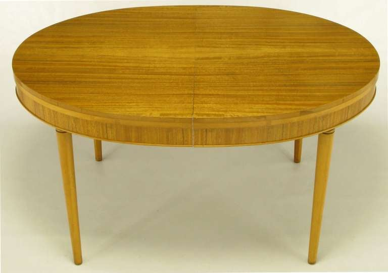 Radiant primavera mahogany with striped grain and racetrack oval shaped dining table. Single 12
