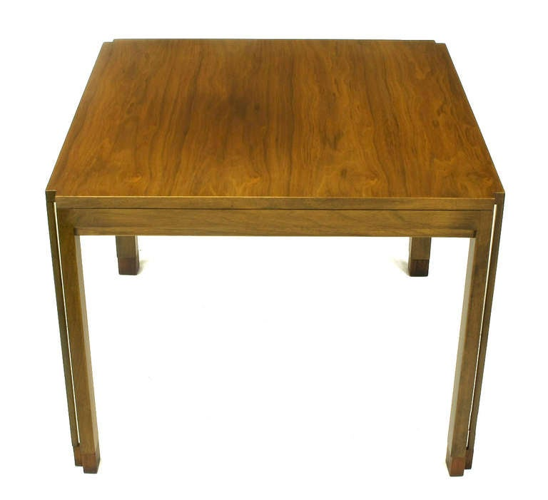 Edward Wormley figured walnut Parsons style side table with unusual aluminium inlaid legs. Incised corners start at the top and move all the way down the legs with aluminium inlay. Recessed apron and rosewood feet.