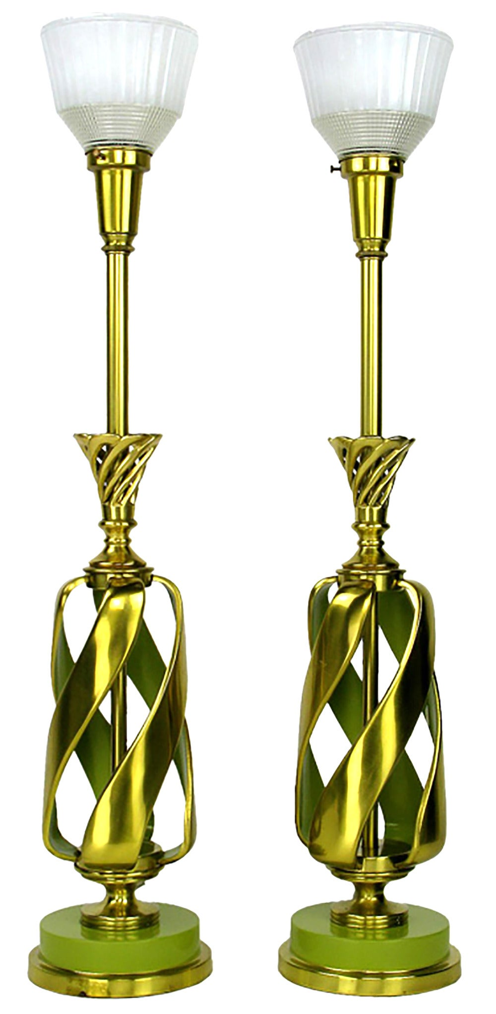 Pair of Rembrandt Lamp Company solid brass table lamps with spiraling open brass body. It is evocative of a pineapple, right up to the cast brass crowns signifying the leaves. Brass stem and milk-glass Holophane diffusers with lacquered chartreuse