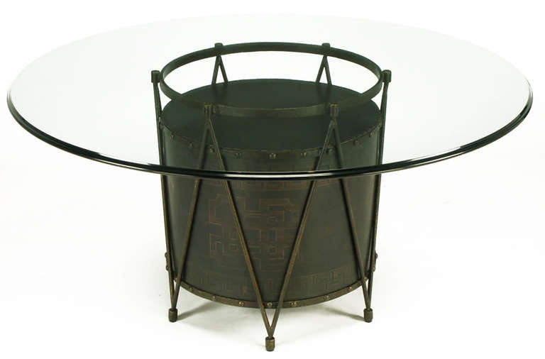 Unexpected bronze-plated drum table base with Greek key design. Six legs come together with the repeated V-shape bronze plated iron bar supports. Top and bottom banding on the drum body is detailed with bronze studs. Can be used as a games table or