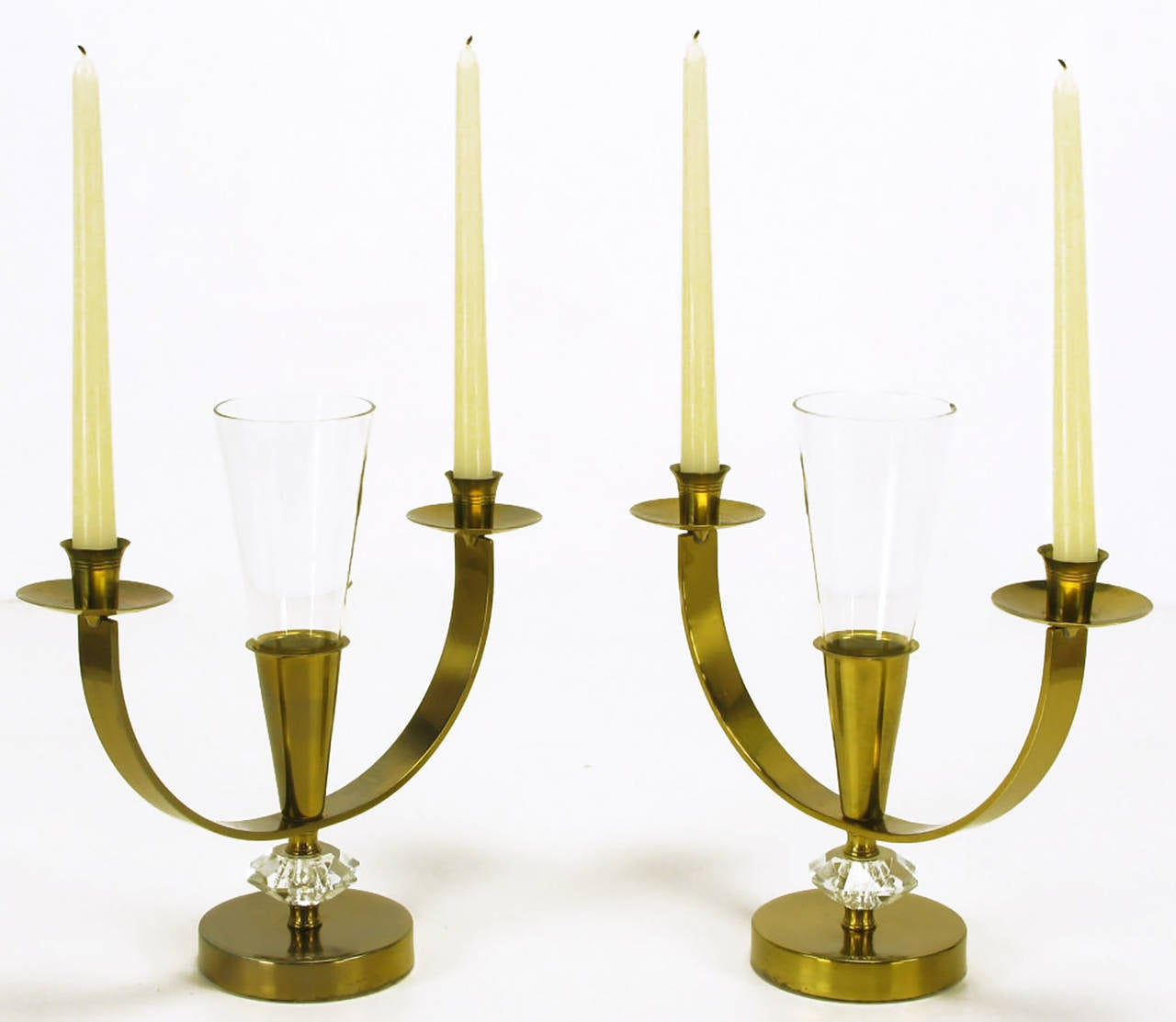 Pair of patinated brass double arm candelabra with cut crystal spacers and leaded crystal fluted center petite vase. Bobeche and striated candle cups are similar to Tommi Parzinger designs for Dorlyn.