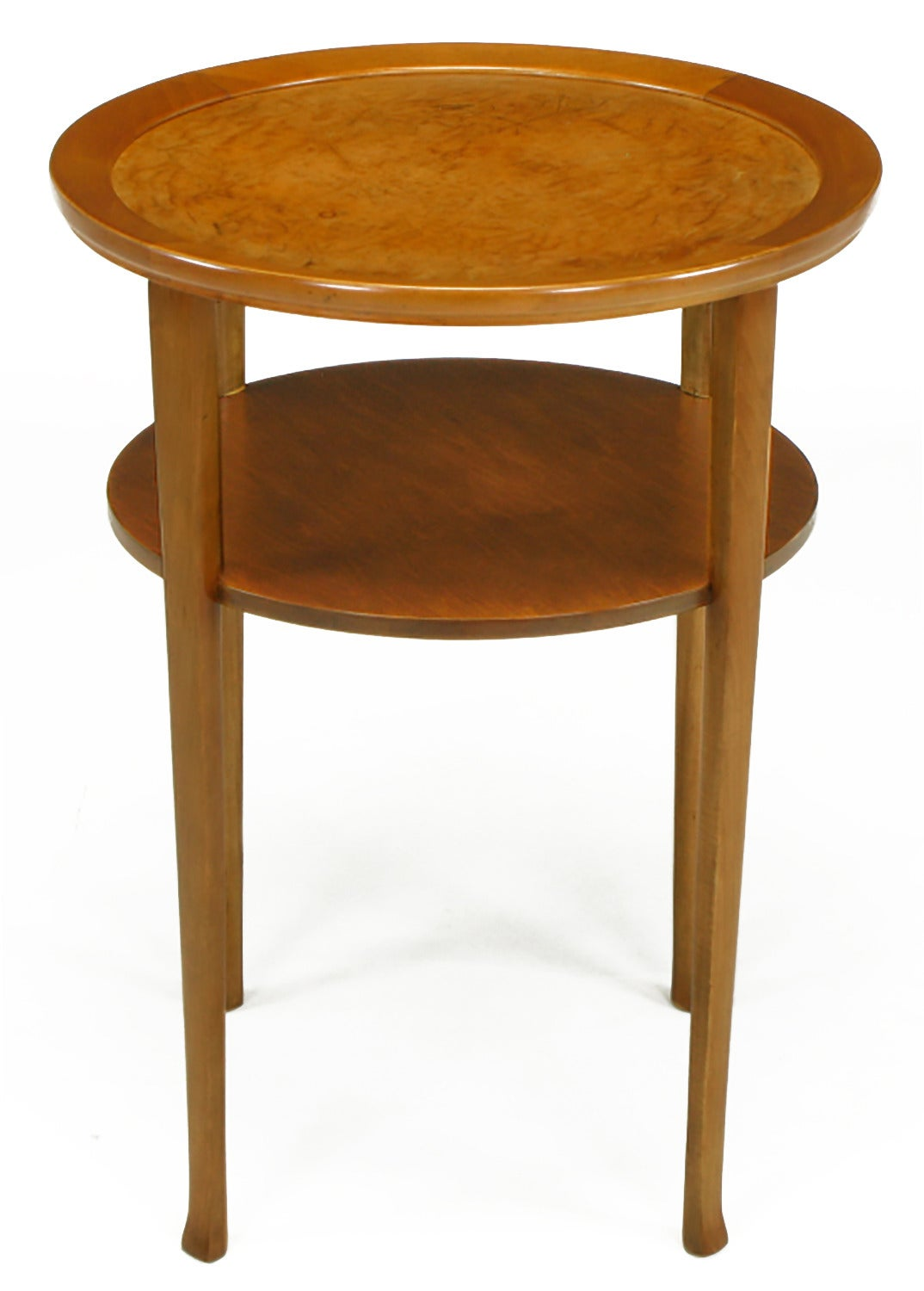Restored side table constructed of solid maple and maple veneer with inlaid buffalo hide top. Similar in design to an early Parzinger designs. Two tiers with solid maple legs and carved, slightly turned feet.