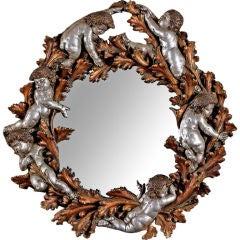 Round Gilt Mirror With Cherubs And Foliate Detail