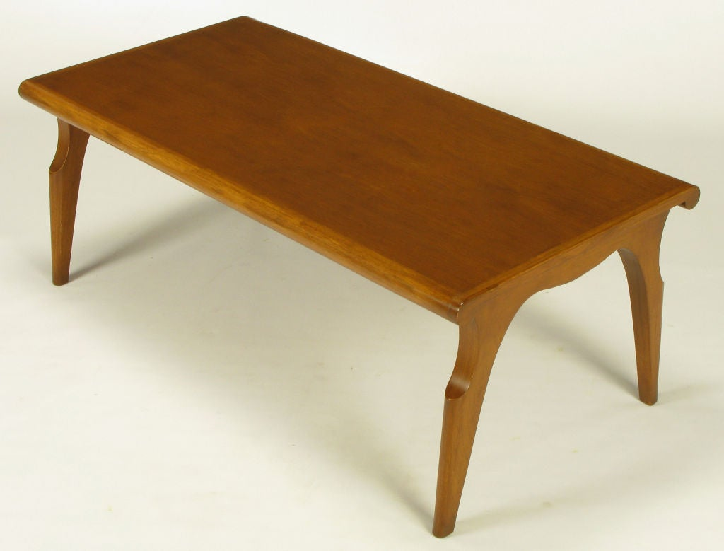 Rare and exquisite sculptural tawny walnut coffee table by John Van Koert for Drexel. Part of the
