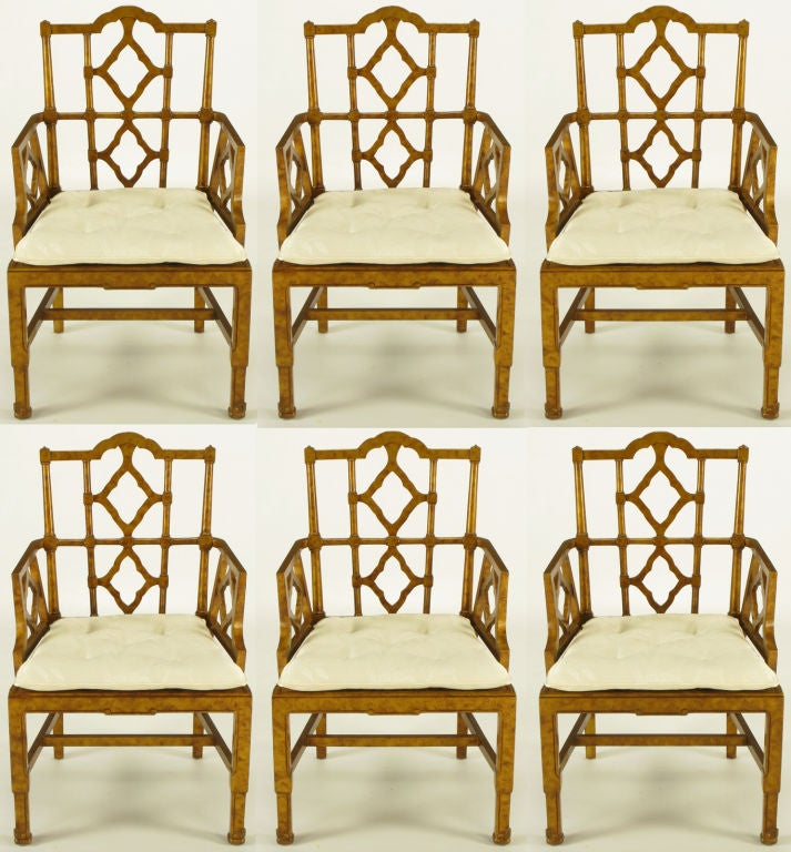 Set of six Chinese Chippendale carved wood dining arm chairs with caned seats. Finished in copper leaf tortoise shell, oil drop glaze. Seats cushions are loose button tufted white silk blend print fabric over cane. <br /> <br /> <br /> arm height