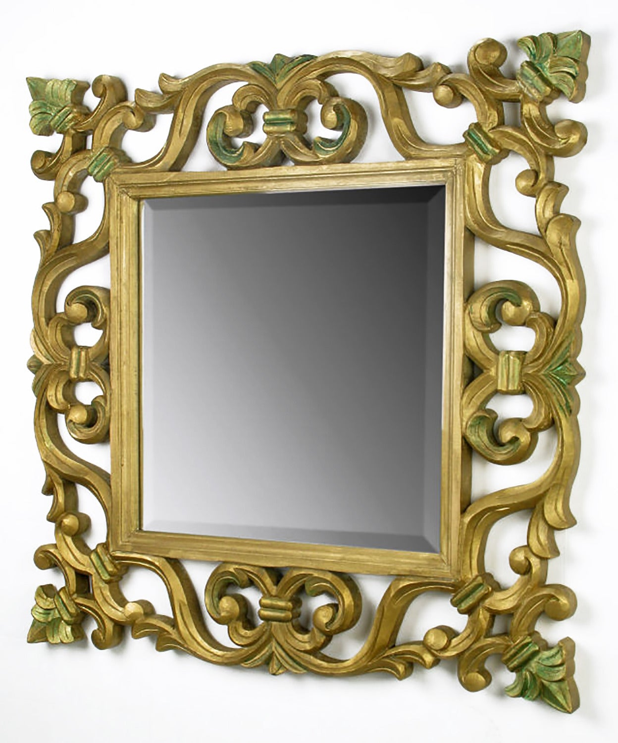 Excellent hand carved and giltwood framed beveled edge mirror with shades of verde accents. Versatile mirror with many applications.