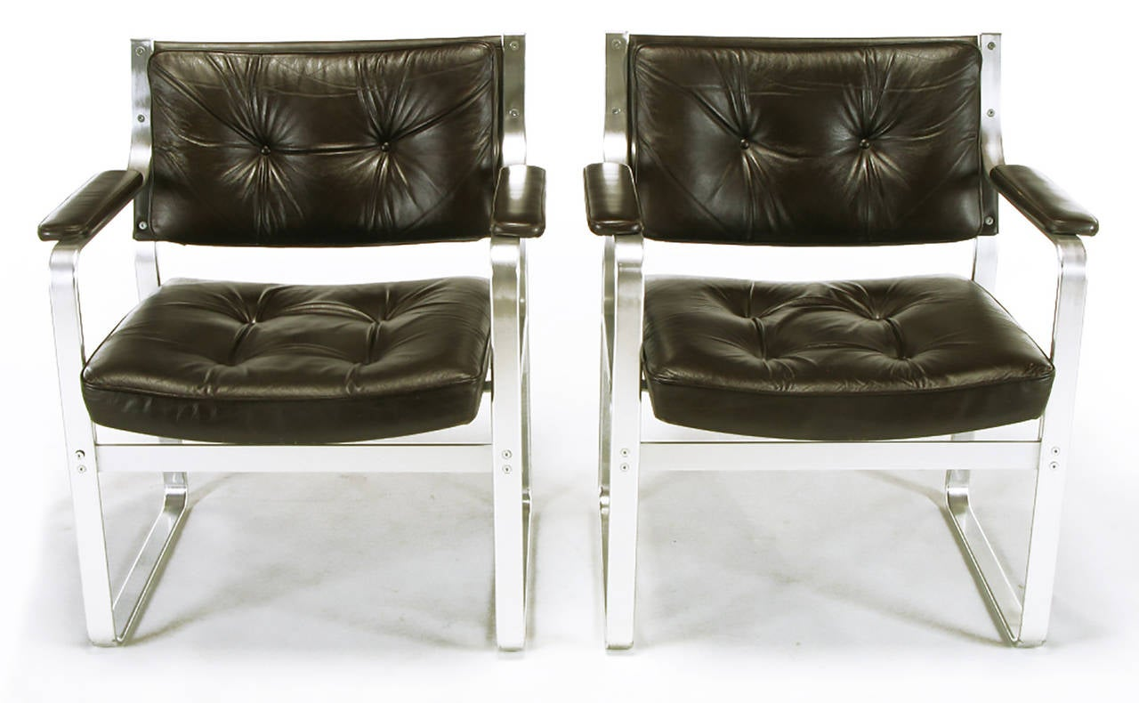 Pair of Mondo armchairs designed by Karl-Erik Ekselius, (1914-1998) for J.O. Carlsson Mobler Vetlanda, Sweden. Polished aluminium frames with dark chocolate leather button tufted seats and backs.